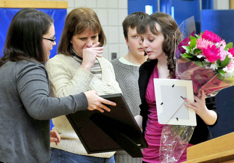 Madison Memorial High School student Lanie Howes, right, receives the Brendan Batson award for fundraising from Make-A-Wish Maine Events Manager Rebecca Leaming, left, on Thursday. Reacting is Batson's mother, Yvonne, and brother, Nathanael.