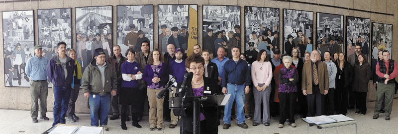 Union president Ginette Rivard speaks during a news conference, held by the Maine State Employees Association, on Tuesday in the Cultural Building atrium in Augusta.