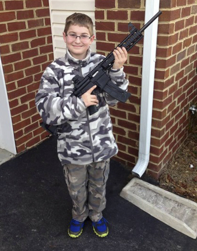 The Moore family claims this photo, posted on Facebook, led the state's child welfare agency to visit the family's house, demanding to be let inside to inspect their guns.