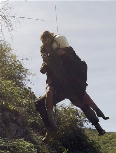 This photo provided by Los Angeles County Search and Rescue Reserve Deputy Doug Cramoline shows the helicopter rescue of Kyndall Jack, 18, by an L.A. County deputy after a rescue team found Jack clinging to an almost vertical canyon wall.