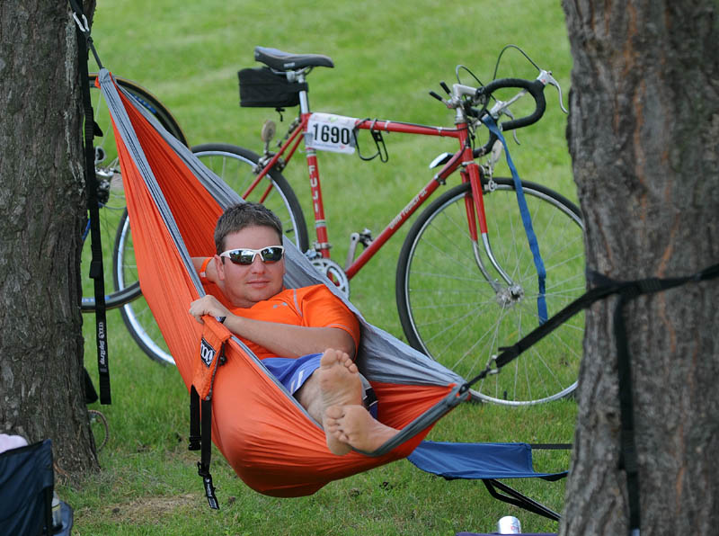 Adam Brandow, of Standish, relaxes in his hammock at Colby College in Waterville after finishing the second leg of the American Lung Association Trek Across Maine.