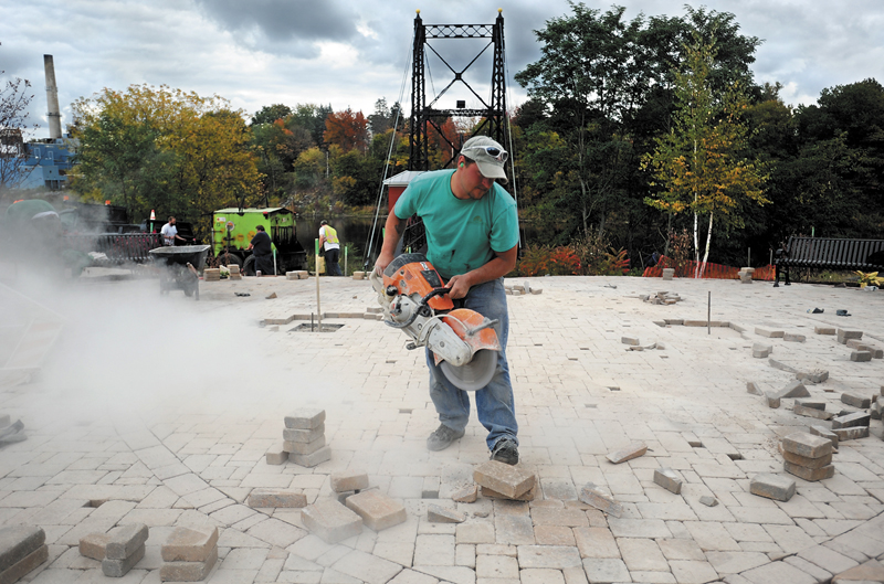 Dave Manning, of Farley and Son Landscaping, helps with the new walkway at Head of Falls in 2010.