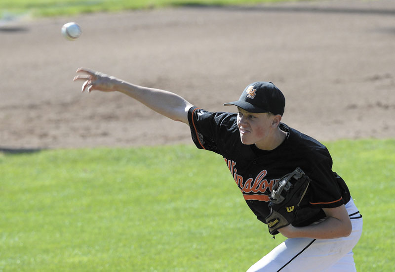 HERE'S THE PITCH: Winslow's Jacob Trask delivers a pitch during the Black Raiders' 4-1 loss to York in the Class B state championship game Saturday in Standish.