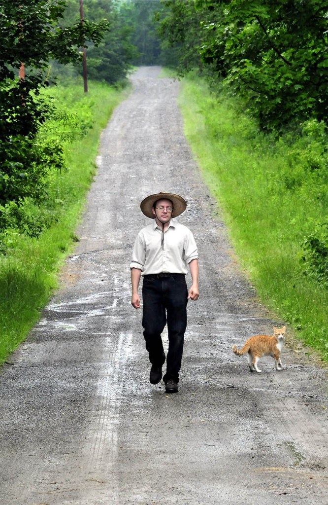 Jacob Underwood walks toward his home in Cornville on the former Nichols Road on Tuesday. Residents this week voted to discontinue the road and eliminate the public easement, effectively giving Underwood ownership of the roadway.