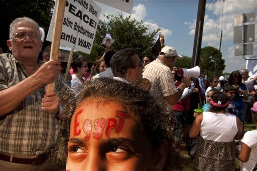 Marvel Merrd, 11, shows her support on her forehead as more than 300 Coptic Christians from Saint Mary & Archangel Michael Coptic Orthodox Church in Houston and other Coptic parishes demonstrate in support of the Egyptian Military in Egypt Sunday, Aug. 18, 2013. They believe Coptic Christians in Egypt are being persecuted by the fundamentalists.
