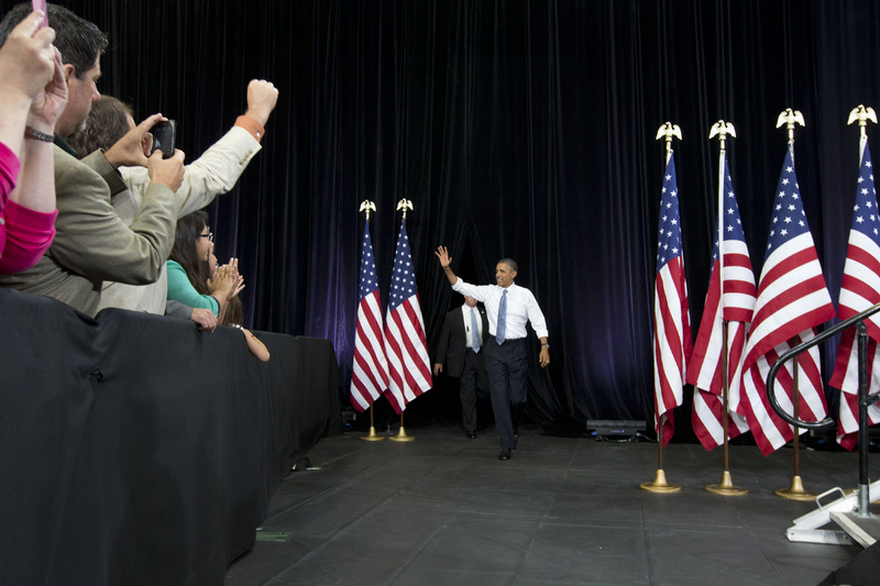 """President Barack Obama waves to the crowd as he arrives to speak about housing Tuesday at Desert Vista High School in Phoenix. Afterward, the president headed to Los Angeles to appear on """"The Tonight Show with Jay Leno."""""""