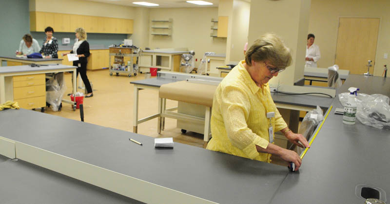 Jessie Mackenzie, a clinical supervisor, checks out her space in the hematology section of the pathology lab on Wednesday at the new Alfond Center for Health regional hospital in Augusta.