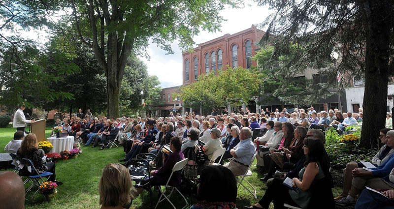 Karen Heck, mayor of Waterville, speaks about the life of Bill Taylor during a celebration of his life, with over 450 of his friends and family at Castonguay Square in downtown Waterville today.