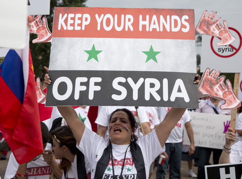 Protesters against U.S. military action in Syria shout during a demonstration in front of the White House in Washington on Monday. On Tuesday, President Barack Obama will address the nation regarding Syria.