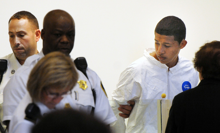 Philip Chism, 14, stands during his arraignment for the death of Danvers High School teacher Colleen Ritzer in Salem District Court in Salem, Mass., Wednesday, Oct. 23, 2013. Chism has been ordered held without bail.