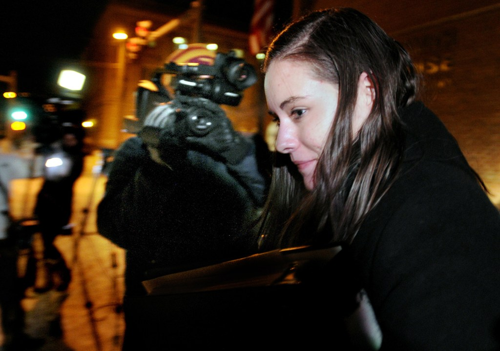 Jordan Graham leaves the Federal Courthouse in Missoula, Mont., Monday after the first day of her murder trial. Graham, 22, is accused of murdering Cody Johnson, her husband of eight days, by pushing him off a cliff in Glacier National Park on July 7.