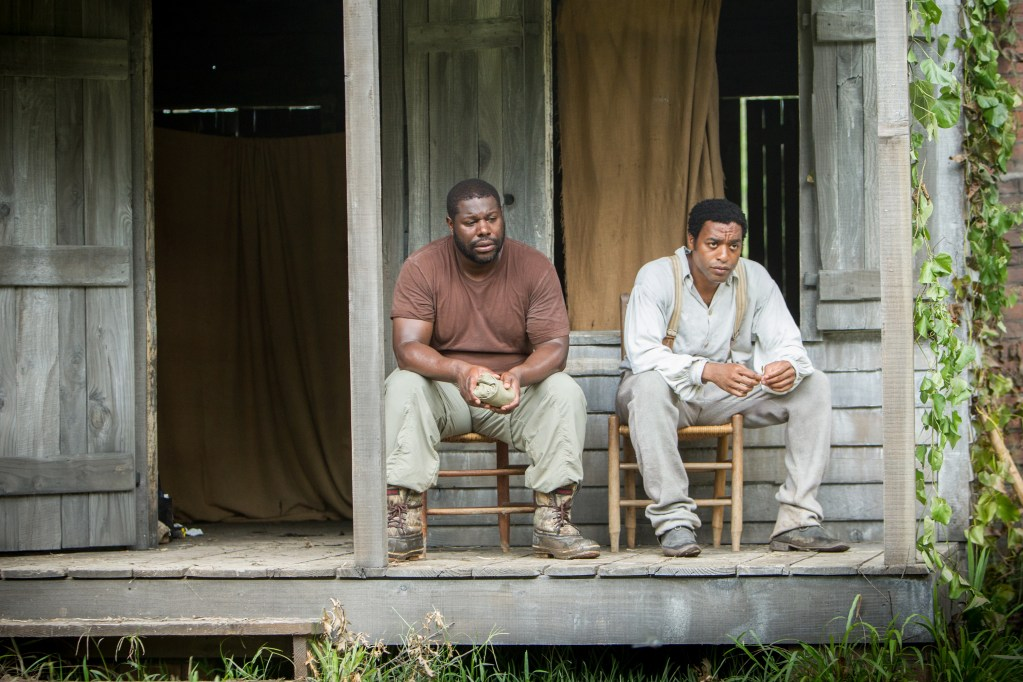 """Director Steve McQueen, left, and actor Chiwetel Ejiofor during the filming of """"12 Years A Slave."""" AP Photo/Fox Searchlight"""