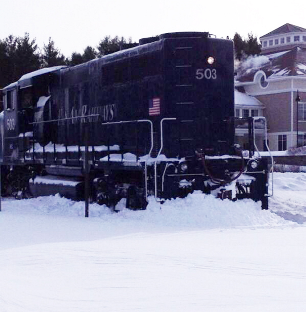 A Pan Am Railways locomotive sits where it slipped off the track near Industrial Park Road in Saco on Friday.
