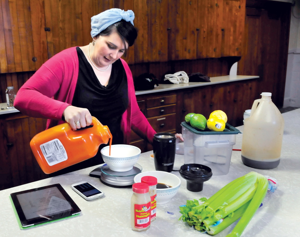 MORNING BREW: Katie Quinn mixes ingredients to her Ass Over Teakettle bloody Mary product she makes in Skowhegan on Thursday.