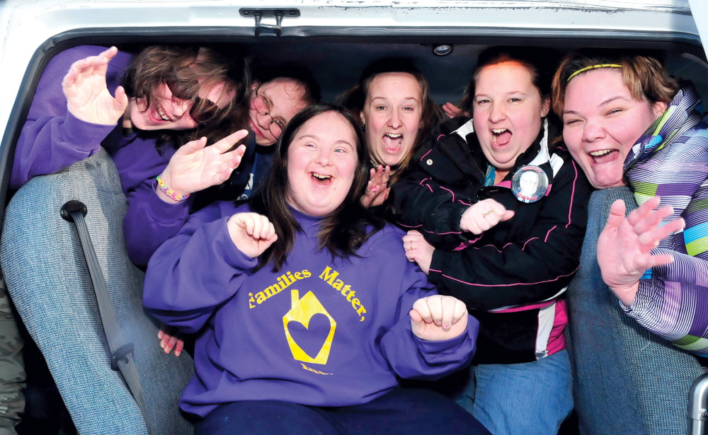 All smiles: These athletes from Families Matter Inc. in Waterville show their enthusiasm as they arrive for the 45th annual Special Olympics Maine Winter Games at Sugarloaf USA on Sunday. The games begin Monday with alpine and nordic skiing, snowshoeing and skating with the help of coaches and hundreds of volunteers. From left are Ashley Cayouette, Ronnie Hood, Caitlin Killarney, front, Shirley Stevens, Shelly Ambrose and Tiffany Carter.