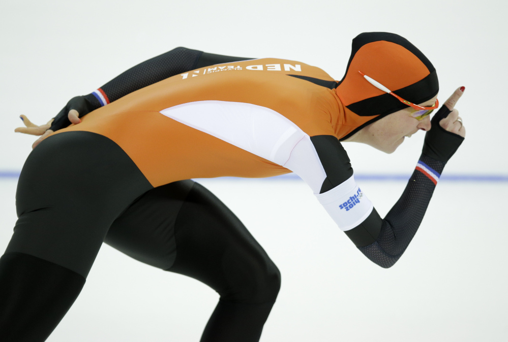Ireen Wust of the Netherlands competes in the women's 3,000-meter speedskating race at the Adler Arena Skating Center during the 2014 Winter Olympics, Sunday in Sochi, Russia. Wust won the gold.