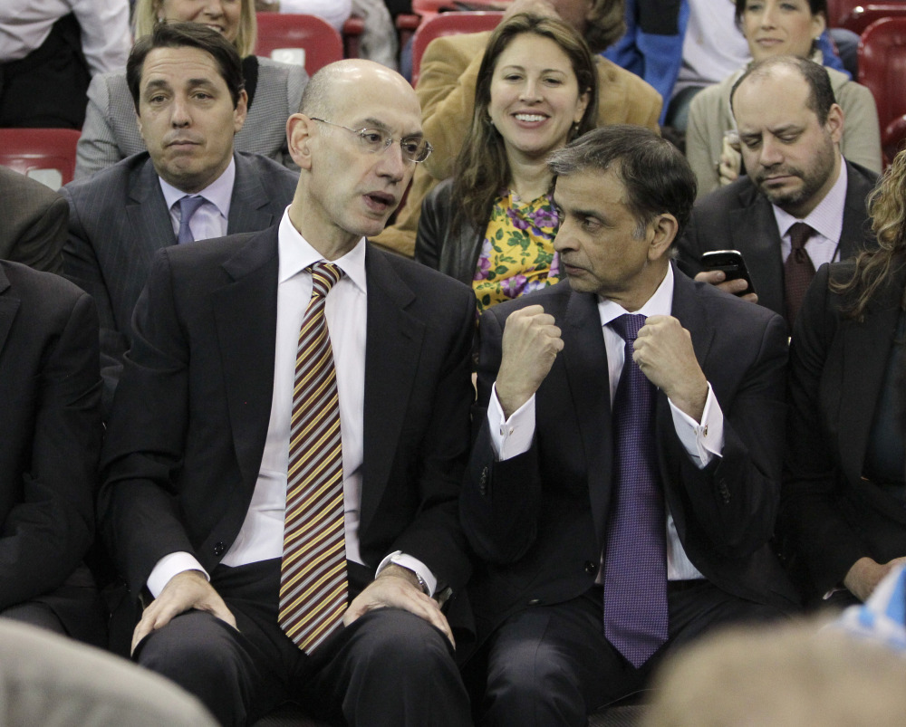 NEW GUY: Adam Silver, left, the new NBA Commissioner, talks with Sacramento Kings majority owner Vivek Ranadive. On Feb. 1 Silver replaced David Stern, who retired after 30 years as the head of the NBA.