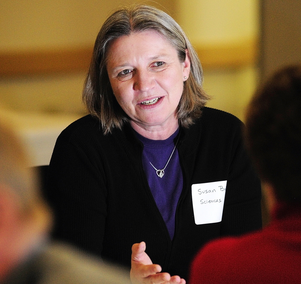 HOW TO HELP: Science professor Susan Baker talks to community leaders Tuesday in Augusta during an event arranged by the University of Maine at Augusta's Office of Civic Engagement.