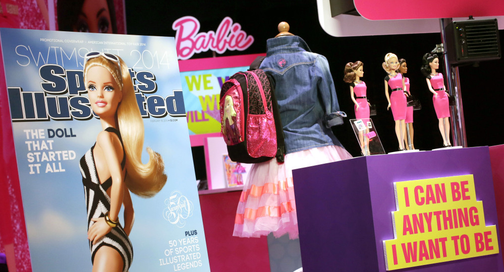 Barbie is featured on a mock-up cover for Sports Illustrated displayed by Mattel at the American International Toy Fair in New York on Feb. 14. Now Barbie is entangled in controversy over ties with the Girl Scouts.