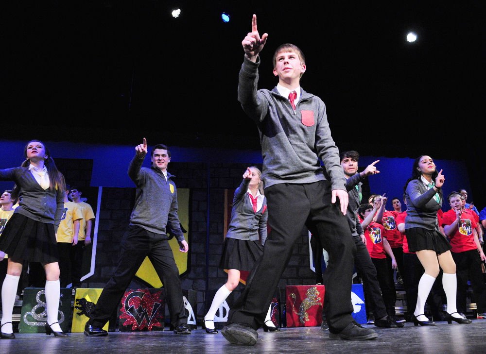 """Looking ahead: Josh Cormier sings """"Baby You Fly My Car"""" during a Chizzle Wizzle rehearsal Friday at Cony High School in Augusta. The show has a Harry Potter theme and the song was an adaption of the Beatles song """"Baby You Can Drive My Car."""""""