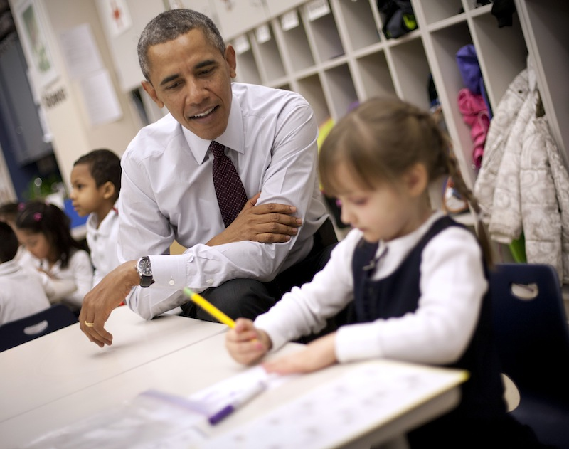 President Barack Obama sits with Emily Hare as she completes her spelling lessons during his visit to a preschool classroom at Powell Elementary School in the Petworth neighborhood of Washington, Tuesday, March 4, 2014. Obama visited the school to talk about his 2015 budget proposal, which was released today. Powell elementary has seen rapid growth in recent years and serves a predominantly Hispanic student body. Washington DC Mayor Vincent Gray, who greeted Obama at the school, recently directed $20 million to Powell for a planned modernization and addition.