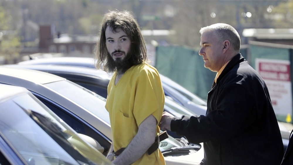 FRUITLESS SEARCH : Leroy H. Smith III heads back to jail last week following his initial appearance in Kennebec County Superior Court.