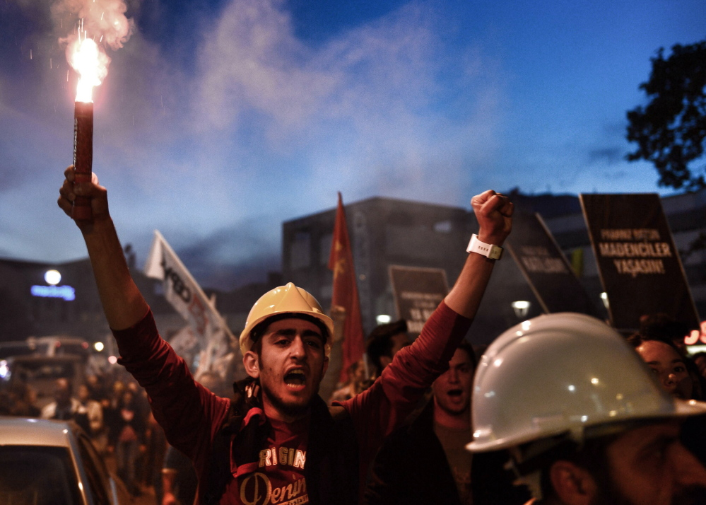 Thousands of protesters march to condemn the Soma mine disaster in Istanbul, Turkey, on Sunday.