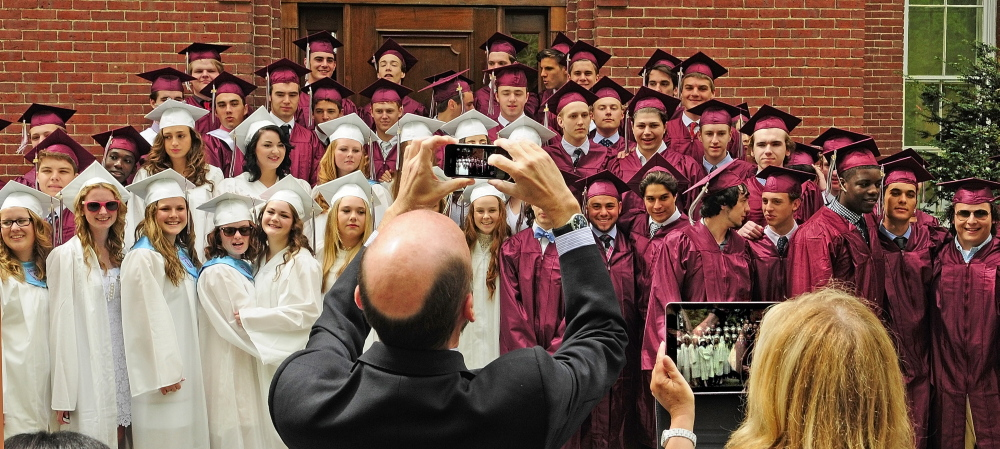 MEMENTOS: Parents take photos of graduates on the steps of Bearce Hall before the graduation ceremony Saturday at Kents Hill School in Readfield.