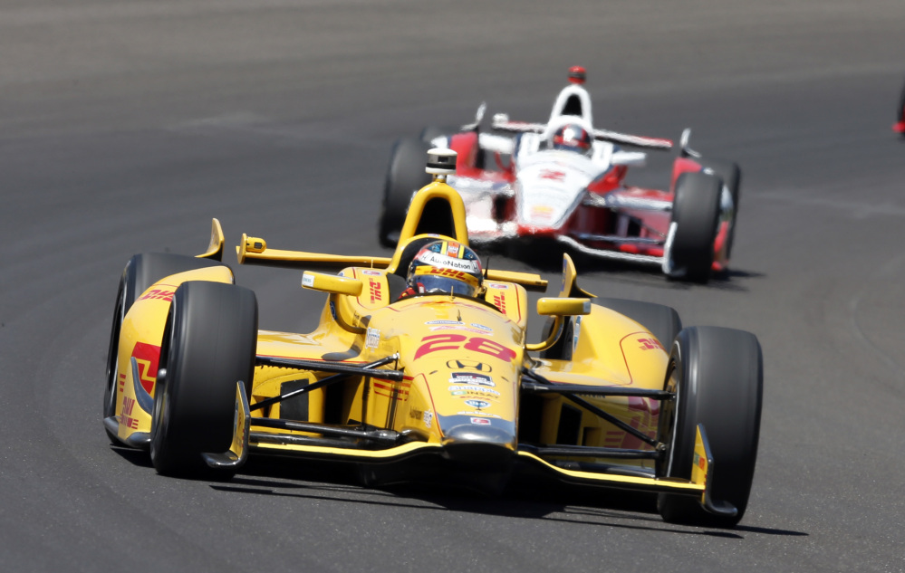 Ryan Hunter-Reay leads Juan Pablo Montoya, of Colombia, through the first turn during the 98th running of the Indianapolis 500 on Sunday.