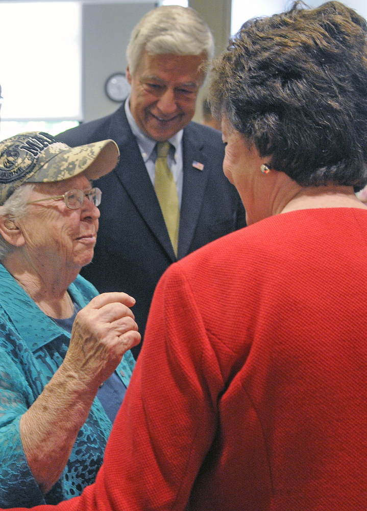 Marine Corps veteran Ruby Gilmore, 83, greets U.S. Rep. Mike Michaud and U.S. Sen. Susan Collins Monday at the women's xlinic at VA Maine Healthcare Systems-Togus during the grand opening.