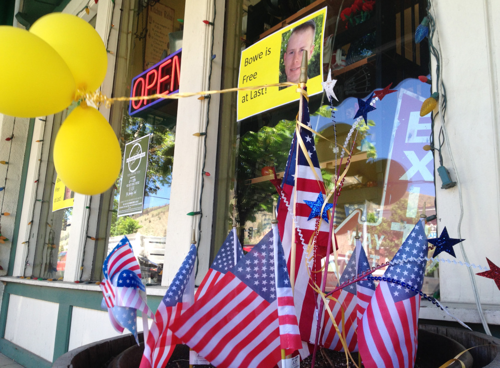 The Associated Press/Brian Skoloff Flags and balloons marking the release from captivity of Sgt. Bowe Bergdahl adorn the sidewalk outside a shop in the soldier's hometown of Hailey, Idaho, Wednesday, June 4, 2014.  The exchange for five Taliban detainees from Guantanamo and the still-murky circumstances of how Bergdahl came to be captured nearly five years ago have prompted a fierce debate in Washington and across the country.