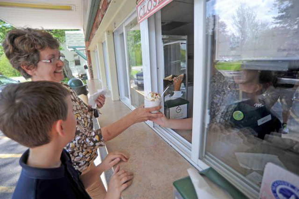 Marge Veilleux and her grandson, Nolan, 9, order ice cream at Gifford's Ice Cream in Waterville in this file photo. The Skowhegan-based company has been working to open a new market in Washington, D.C.