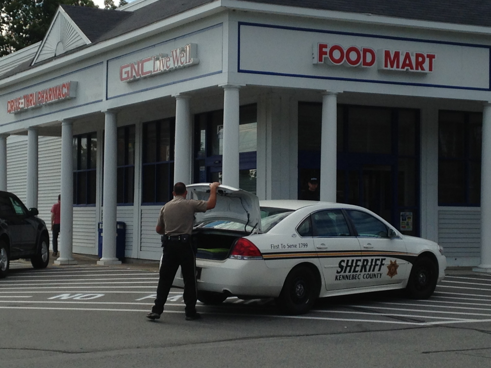 Kennebec County Sheriff's deputies responded to a robbery at the Manchester Rite Aid around 3:15 this afternoon. A woman dressed in men's clothes held up the pharmacy for prescription drugs and fled on foot. A K9 unit was brought in to track the path of the robber's flight.