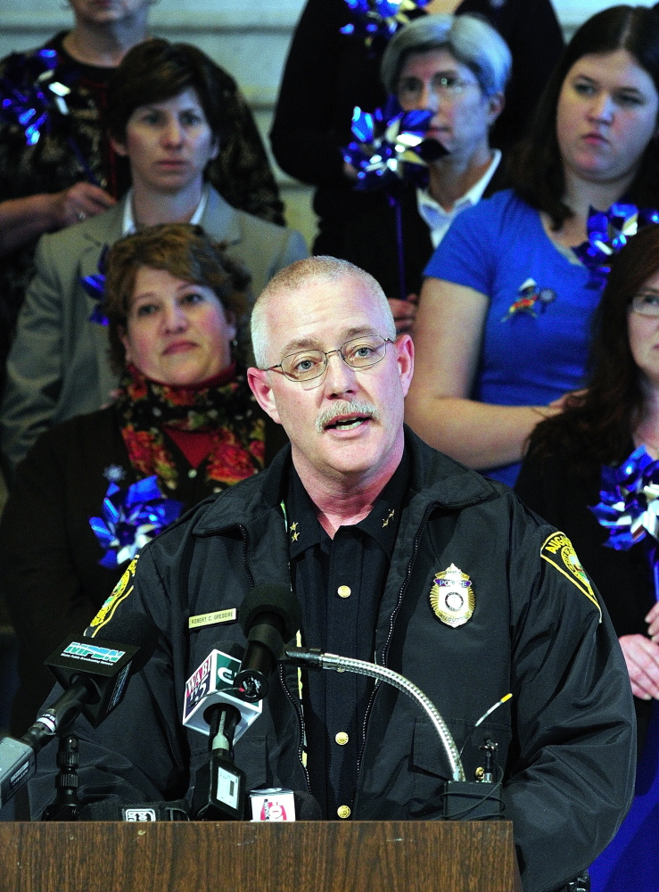 Augusta Police Chief Robert Gregoire speaks during a news conference held in the State House Hall of Flags on Tuesday April 1, 2014.