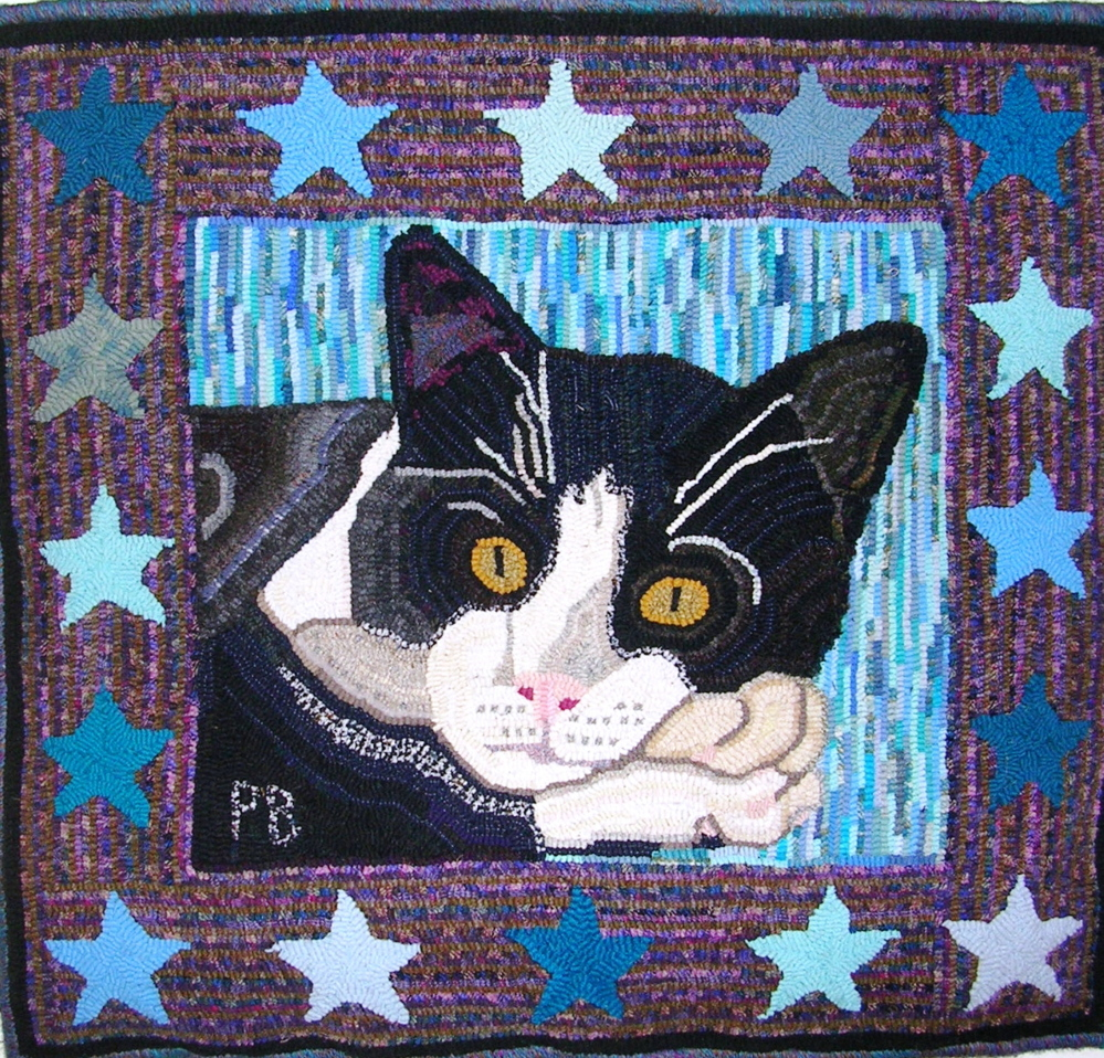 """""""Cat with Stars,"""" a hooked rug by Paula Benne is among the artwork on display at the Fire Station on Saturday during Whitefield Community Days."""