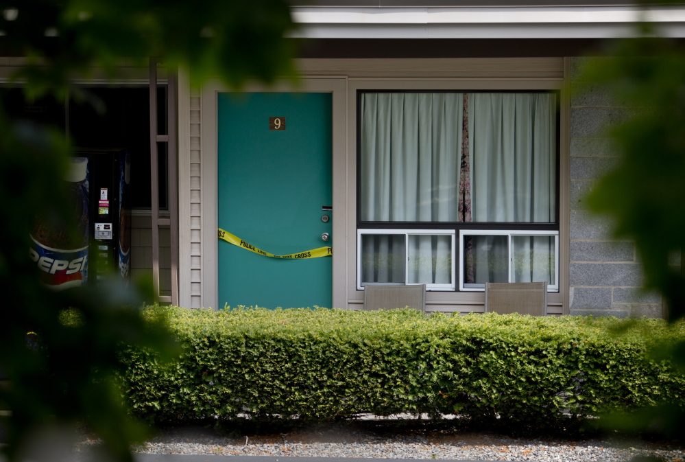 Crime scene tape drapes a door at the Sleepy Hollow Motel in Biddeford on Wednesday after police recovered two bodies Tuesday night. The victims were Daniel Pelletier, 28, and Lynda Norton, 31, both of Biddeford.