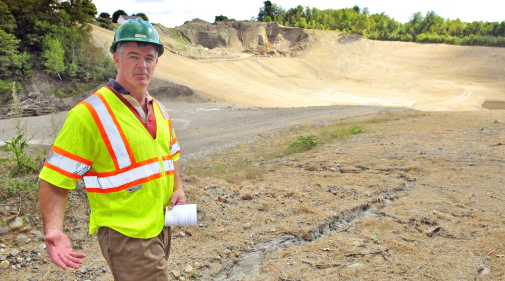 Brian Tarbuck, general manager of the Greater Augusta Utility District, leads a tour of a former gravel pit that is the district's new east side well complex off Riverside Drive in Augusta.