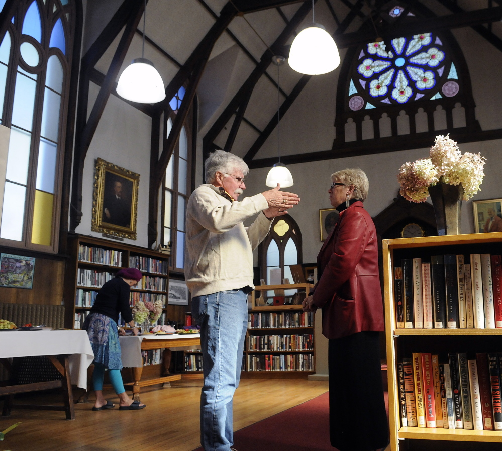 Guests visit the Hubbard Free Library Sunday as the Hallowell institution celebrates achieving its fundraising goal for the first phase of a capital campaign. While several hundred thousand dollars has helped repair the exterior of the 19th century structure, more money is needed to protect and restore the stained windows at the library.