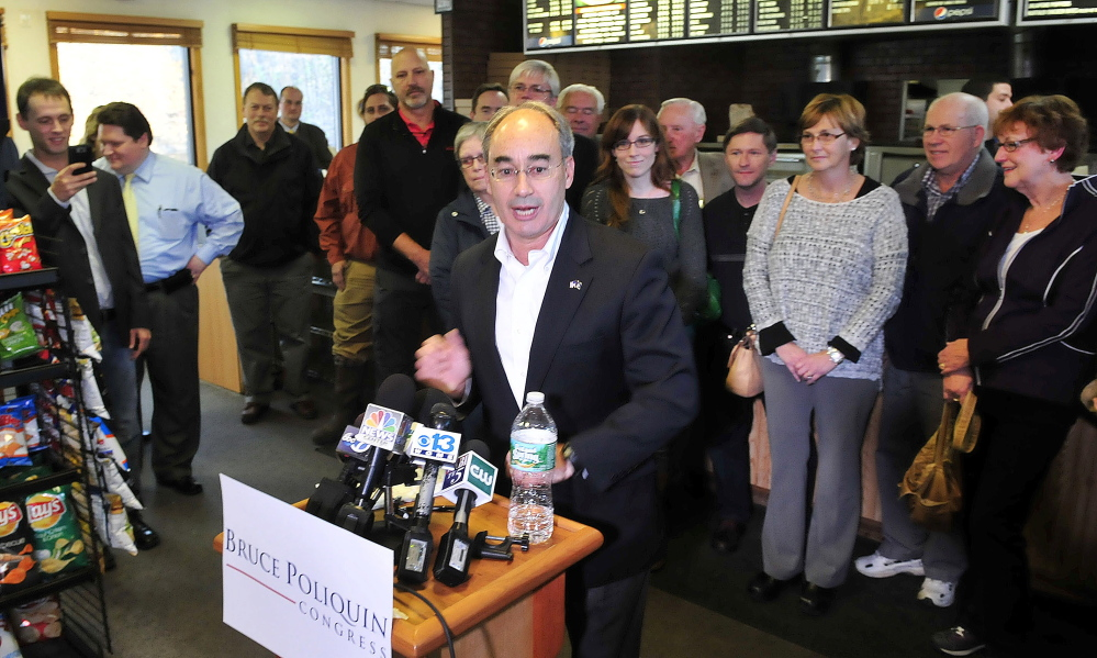 Bruce Poliquin speaks during a news conference Wednesday, surrounded by supporters at the Oakland House of Pizza. He won convincingly Tuesday in his bid to represent Maine's 2nd Congressional District.