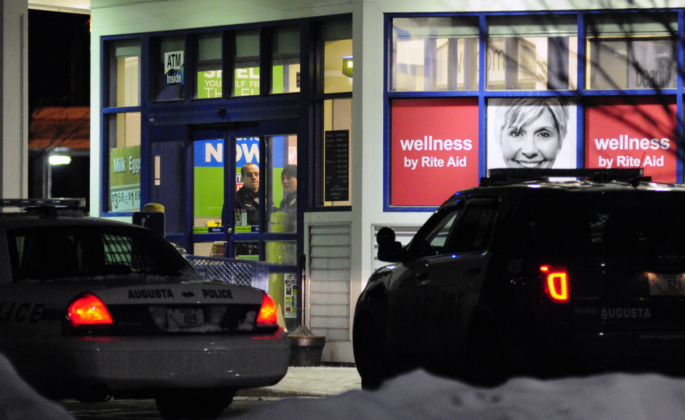 Augusta police officers investigate a robbery around 6:15 p.m.on Saturday at the Rite Aid pharmacy at the corner of North Belfast Avenue and Bangor Street in Augusta.
