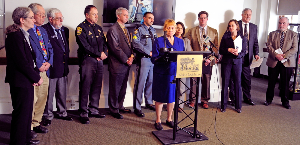 Attorney General Janet Mills talks about the Financial Crimes Against the Elderly report during a news conference on Wednesday at the State House in Augusta.