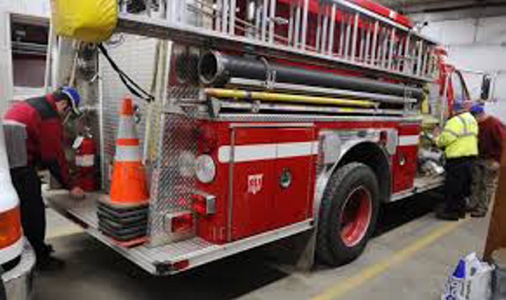 Volunteer Chesterville firefighters keep their gear in shape for the next call. State lawmakers Monday held a public hearing on legislation to provide financial incentives for volunteer firefighters.