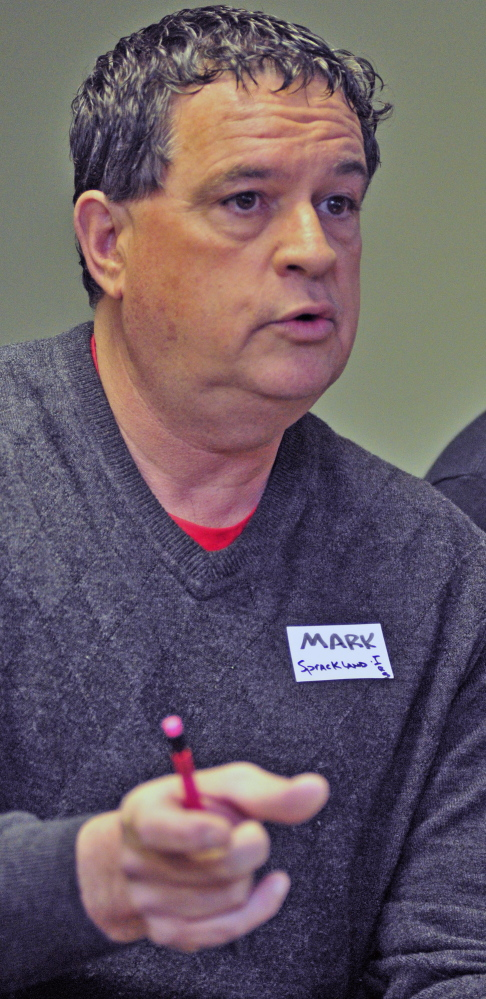 Mark Sprakland, executive director of the Independent Retailers Coop, speaks during a conference on business cooperatives Saturday at the Viles Arboretum in Augusta.
