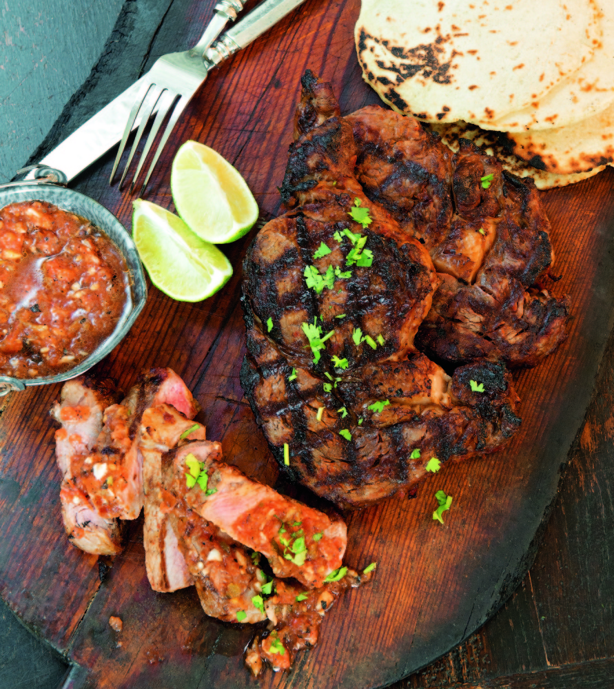 """Shannon Bard's red chile-marinated rib eye steaks, one of more than 100 recipes in """"The Gourmet Mexican Kitchen."""""""