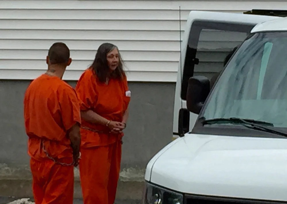 Carol Murphy is led from Franklin County Superior Court Friday after a failure-to-appear hearing. Murphy was found in contempt of court in October for having pets after she had been banned in 2005 and 2010 from owning animals.
