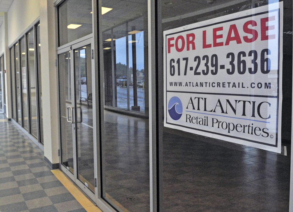 Signs advertising retail space for lease hang in the windows of several empty shops Tuesday at the Turnpike Mall in Augusta.