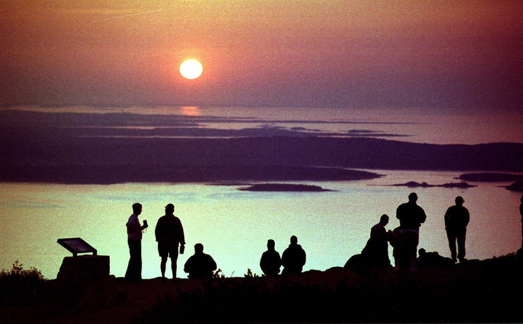 For years, visitors to Acadia National Park have gathered to watch the sun rise from the summit of Cadillac Mountain near Bar Harbor.
