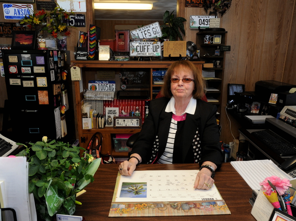 Claudia Viles, tax collector for the town of Anson, sits at her desk Thursday at the Town Office in Anson. Despite a lawsuit against Viles by the town related to $438,000 in missing town money, she is still working.