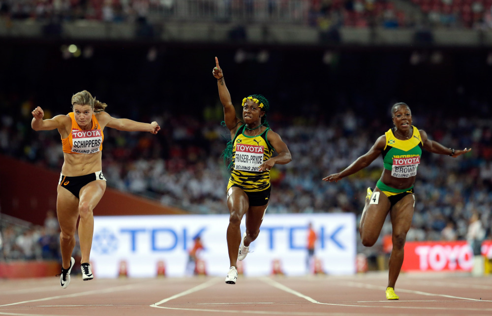 AP photo   Jamaica's Shelly-Ann Fraser-Pryce, middle, celebrates after winning the women's 100-meter final at the World Athletics Championships at the Bird's Nest stadium in Beijing on Monday. Dafne Schippers of the Netherlands, left, finished second. Jamaica's Veronica Campbell-Brown is at right.