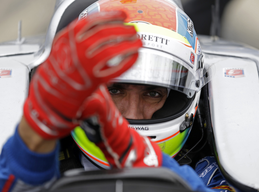 Justin Wilson was in a coma in critical condition after sustaining a head injury when he was hit by a large piece of debris that broke off another car in the crash-filled race at Pocono Raceway on Sunday.
